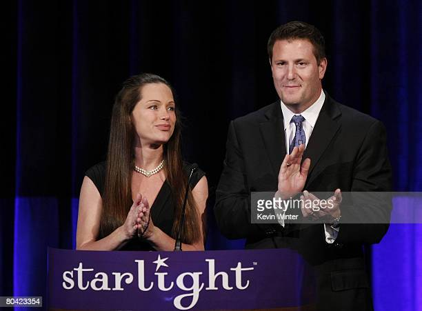 Event CoChairs Kevin Mayer Exec VP Walt Disney Company and his wife Lisa appear onstage at the Starlight Starbright Children's Foundation's A Stellar...
