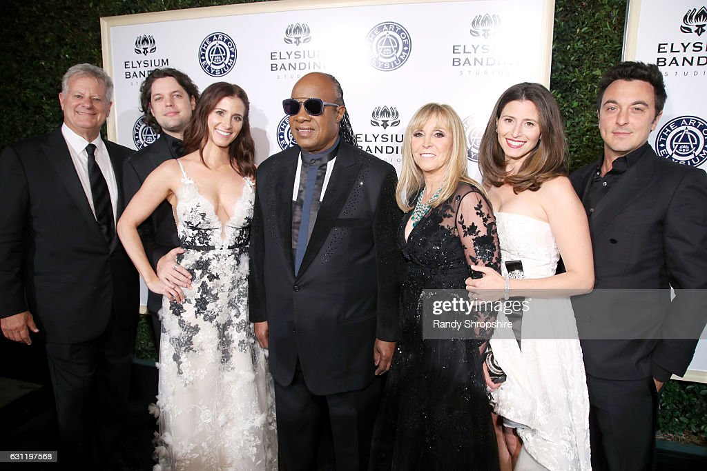 Event co-chairs Michael Smith, Adam Westbrook and Kaily Westbrook, musician Stevie Wonder and event co-chair Iris Smith and guests attend The Art of Elysium presents Stevie Wonder's HEAVEN - Celebrating the 10th Anniversary at Red Studios on January 7, 2017 in Los Angeles, California.