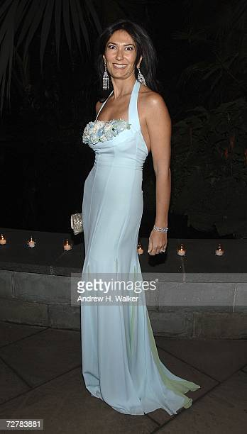 Event committee member Nazee Moinian dressed in a blue chiffon ESCADA halter gown attends the ESCADA and The New York Botanical Garden Winter...