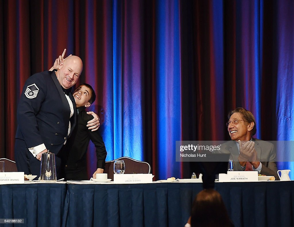 Event honoree Christopher A. Irving hug his son during the 75th Annual Father Of The Year Awards Luncheon at New York Marriott Marquis Hotel on June 14, 2016 in New York City.