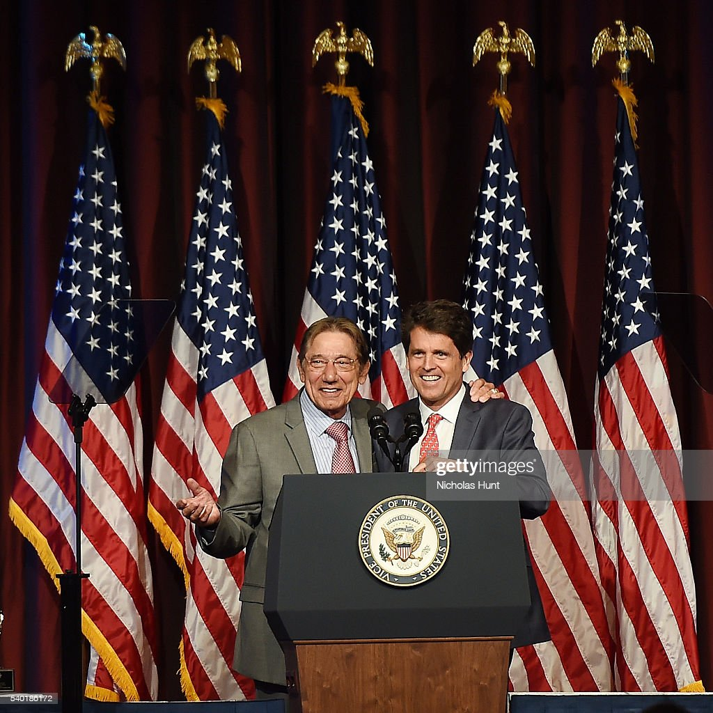 Event honoree Joe Namath (L) and President of Save the Children Action Network, Mark Shriver pose for a picture on stage during the 75th Annual Father Of The Year Awards Luncheon at New York Marriott Marquis Hotel on June 14, 2016 in New York City.