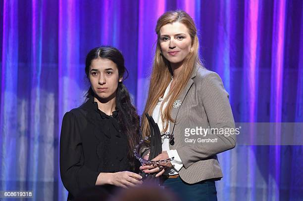 Event honoree Nadia Murad accepts her award from survivor of the Srebrenica genocide Advija Ibrahimovic on stage at the 10th Annual Clinton Global...