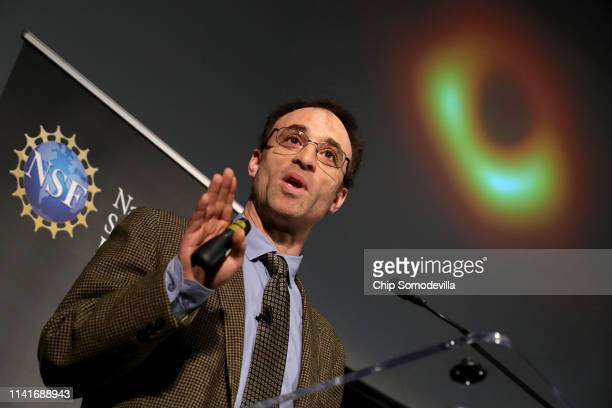 Event Horizon Telescope Director Sheperd Doeleman reveals the first photograph of a black hole during a news conference organized by the National...