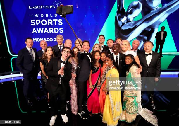 Event host James Marsden takes a selfie on stage with some of the winners from the nights awards and Albert Prince of Monaco following the 2019...