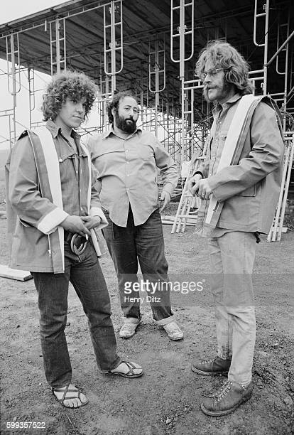Event producer Michael Lang speaks with two men during construction at the free Woodstock Music and Art Fair The festival took place on Max Yasgur's...