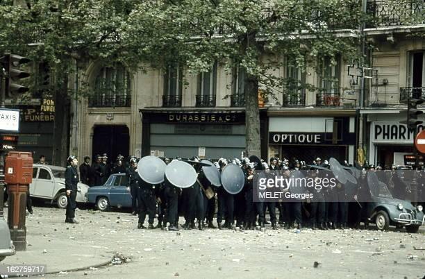 Events Of May 1968 In Paris: Demonstrations. Les évênements de mai 68 à PARIS : journée du lundi 6 mai 1968 : les C.r.s. Se protégeant avec leurs...