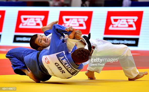Eventual bronze medallist, Amiran Papinashvili of Georgia throws Ashley McKenzie of Great Britain for an ippon to win their u60kg contest during the...