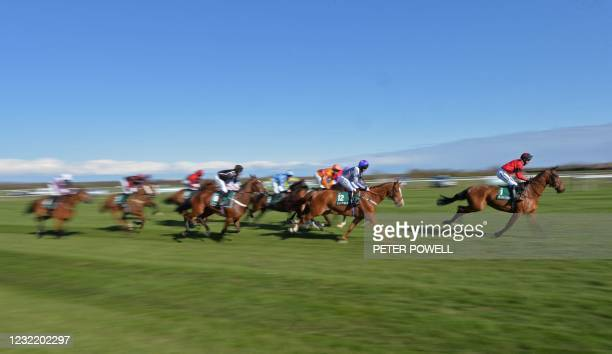 Eventual winner Ahoy Senor, ridden by Derek Fox lead the field in the Sefton Novices' Hurdle on Ladies Day of the Grand National Festival at Aintree...