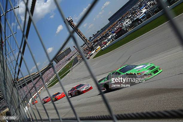 Eventual winner Bobby Labonte driver of the Joe Gibbs Racing Chevrolet Monte Carlo leads the field during the NASCAR MBNA 500 on March 9 2003 at the...