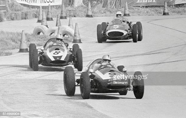Eventual winner Bruce McLaren of New Zealand, fights his Coper-climax car through the S-turns on the Sebring 5-2 mile course. McLaren won when the...