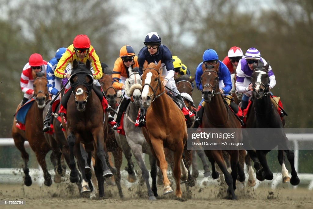 Horse racing easter family fun day kempton park racecourse eventual winner nazeef ridden by darryll holland left leads from maverik ridden by richard negle Image collections