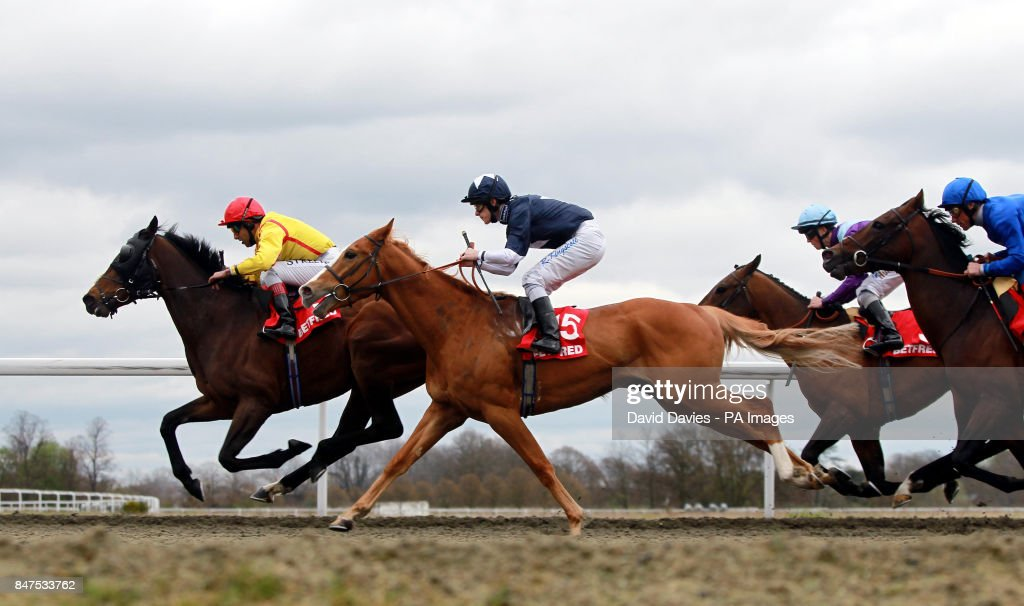 Horse racing easter family fun day kempton park racecourse eventual winner nazeef ridden by darryll holland leads from maverik ridden by richard kingscote during the negle Gallery