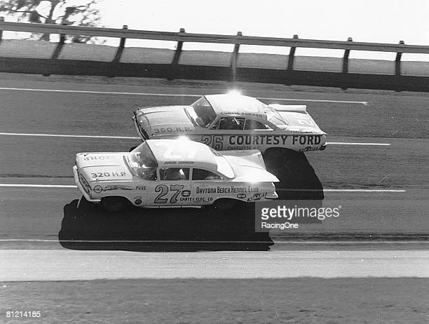 Eventual winner of the 1960 Daytona 500 Junior Johnson ducks beneath Curtis Turner who finished 7th during the Daytona 500 on February 14 1960 at the...