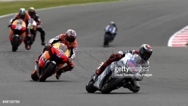 Eventual winner Spain's Jorge Lorenzo leads Australia's Casey Stoner during the British round of Moto GP at Silverstone Circuit, Northamptonshire.