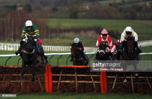 Eventual winner Tony McCoy jumps the last with High Storm ridden by Rchard Johnson in the E B F Jenny Mark Pitman Gold Syndicates National Hunt...