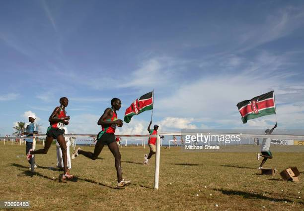 Eventual winners Asbel Kiprop and Vincent Kiprop Chepkok of Kenya compete in the men's junior race at the IAAF World Cross Country Championships on...