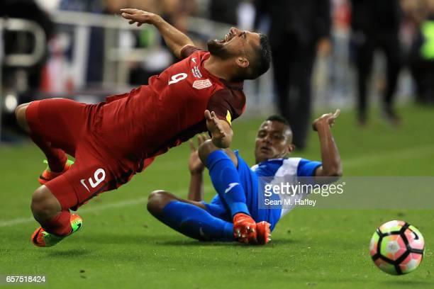 Ever Alvarado of Honduras trips Sebastian Lletget of the United States during their FIFA 2018 World Cup Qualifier at Avaya Stadium on March 24 2017...