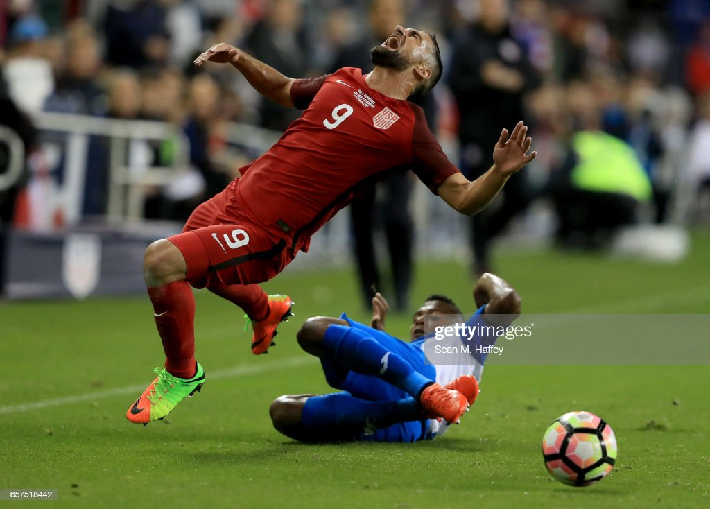 Ever Alvarado #5 of Honduras trips Sebastian Lletget #9 of the United States during their FIFA 2018 World Cup Qualifier at Avaya Stadium on March 24, 2017 in San Jose, California.