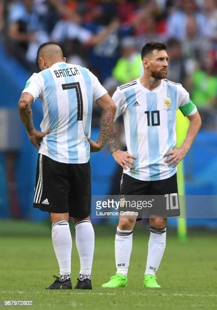 Ever Banega and Lionel Messi of Argentina look dejected following the 2018 FIFA World Cup Russia Round of 16 match between France and Argentina at...