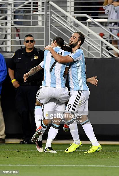 Ever Banega Angel Di Maria and Gonzalo Higuain of Argentina of Argentina celebrates after Banega scored a goal against Chile during the 2016 Copa...