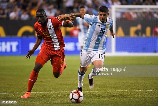 Ever Banega of Argentina and Abdiel Arroyo of Panama fight for the ball during a group D match between Argentina and Panama at Soldier Field as part...