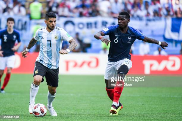 Ever Banega of Argentina and Paul Pogba of France during the FIFA World Cup Round of 16 match between France and Argentina at Kazan Arena on June 30...