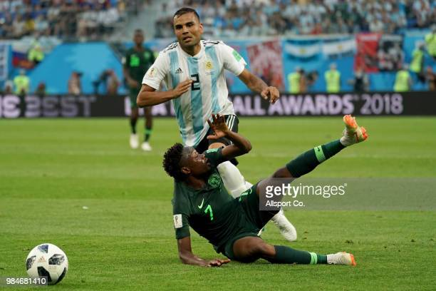 Ever Banega of Argentina battles with Ahmed Musa of Nigeria during the 2018 FIFA World Cup Russia group D match between Nigeria and Argentina at...