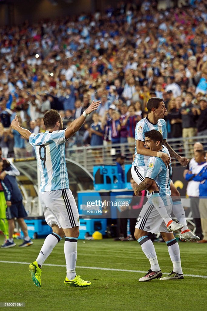 Ever Banega of Argentina celebrates a goal against Chile with his teammates Angel Di Maria and Gonzalo Higuain in the second half during a group D match at Levi's Stadium as part of Copa America Centenario US 2016 on June 06, 2016 in Santa Clara, California, US.