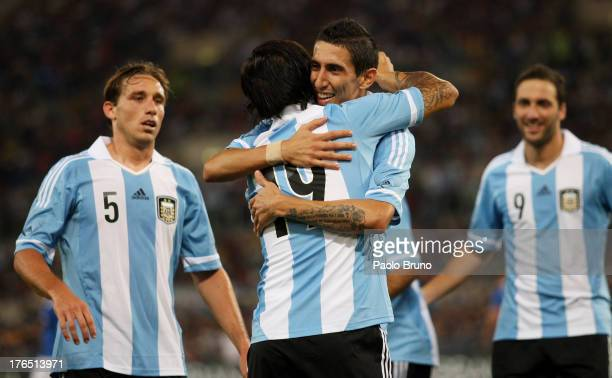 Ever Banega of Argentina celebrates with teammates Angel Di Maria Lucas Biglia and Gonzalo Higuain after scoring the second team's goal during the...