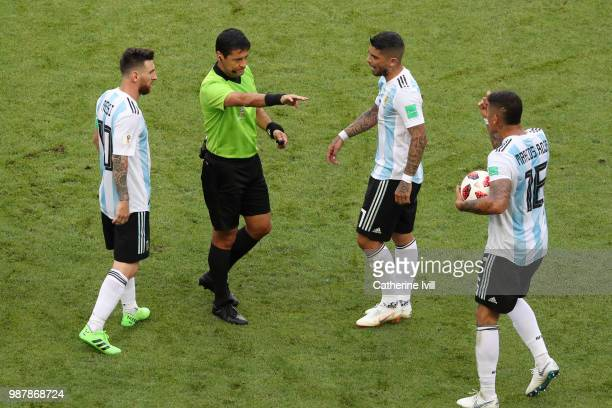Ever Banega of Argentina confronts referee Alireza Faghani during the 2018 FIFA World Cup Russia Round of 16 match between France and Argentina at...
