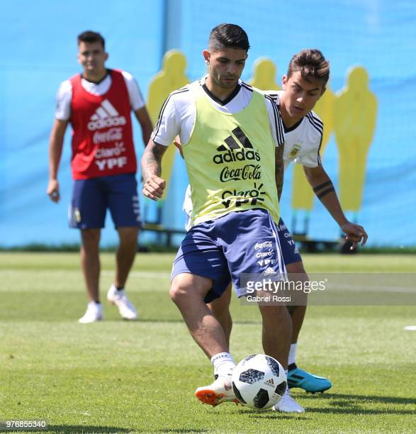 Gabriel Mercado and Cristian Pavon of Argentina talk during a training session at the team base camp on June 17 2018 in Bronnitsy Russia
