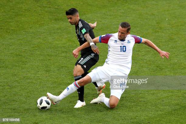 Ever Banega of Argentina is challenged by Gylfi Sigurdsson of Iceland during the 2018 FIFA World Cup Russia group D match between Argentina and...
