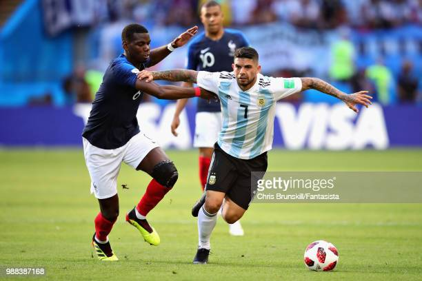 Ever Banega of Argentina is challenged by Paul Pogba of France during the 2018 FIFA World Cup Russia Round of 16 match between France and Argentina...
