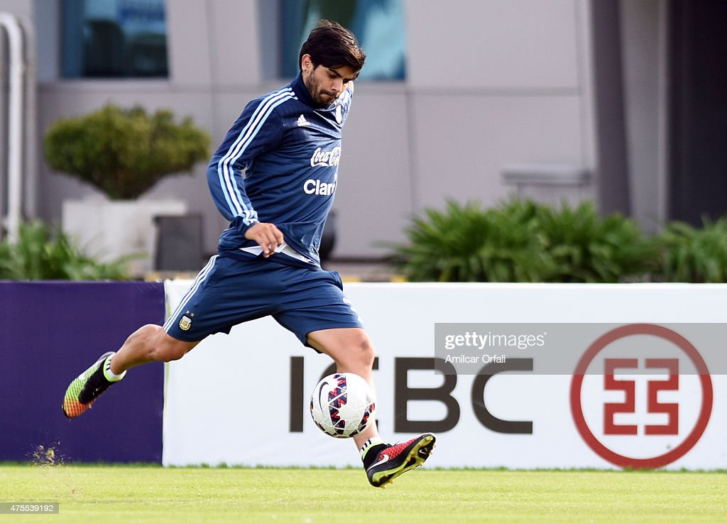 Ever Banega of Argentina kicks the ball during a training session at Argentine Football Association 'Julio Humberto Grondona' training camp on June 01, 2015 in Ezeiza, Argentina. Argentina will face its first match as part of Copa America Chile 2015 against Paraguay on June 13th, 2015.
