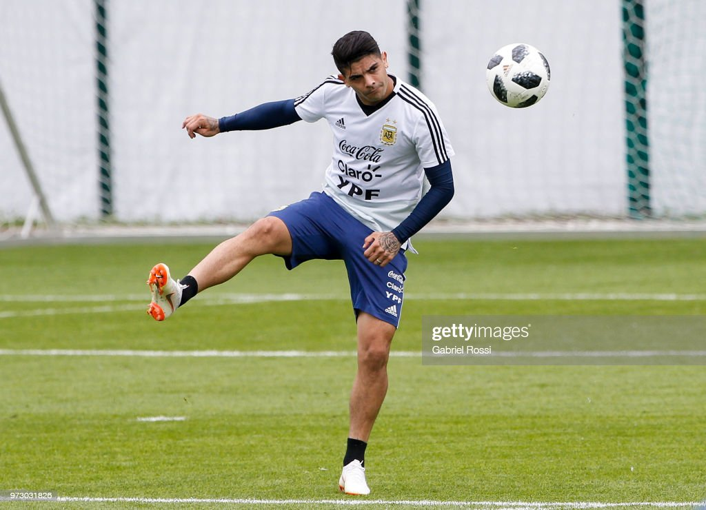 Ever Banega of Argentina kicks the ball during a training session at the team base camp on June 13, 2018 in Bronnitsy, Russia.