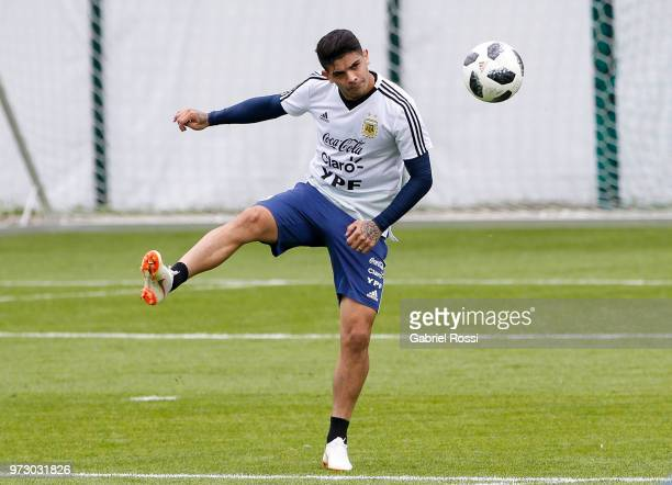 Ever Banega of Argentina kicks the ball during a training session at the team base camp on June 13 2018 in Bronnitsy Russia