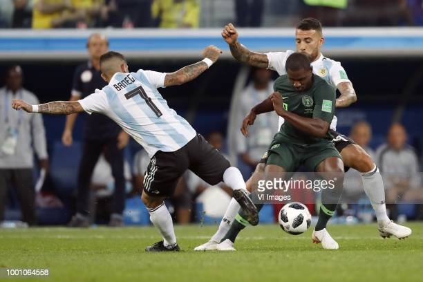 Ever Banega of Argentina Odion Ighalo of Nigeria Nicolas Otamendi of Argentina during the 2018 FIFA World Cup Russia group D match between Nigeria...