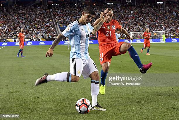 Ever Banega of Argentina shoots on goal past Marcelo Diaz of Chile during the 2016 Copa America Centenario Group match play between Argentina and...