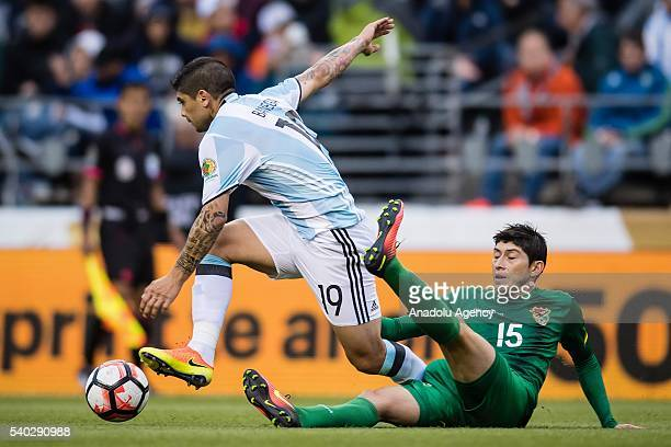 Ever Banega of Argentina struggles for the ball against Pedro Azogue of Bolivia during the 2016 Copa America Centenario Group D match between...