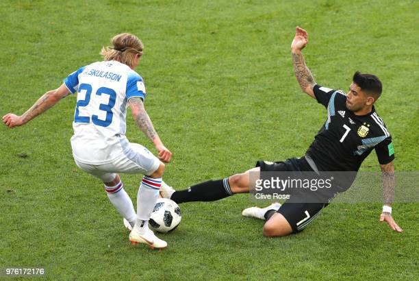 Ever Banega of Argentina tackles Ari Skulason of Iceland during the 2018 FIFA World Cup Russia group D match between Argentina and Iceland at Spartak...