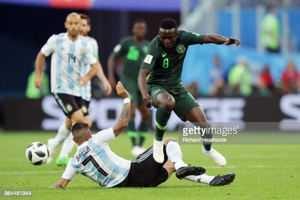 Ever Banega of Argentina tackles Oghenekaro Etebo during the 2018 FIFA World Cup Russia group D match between Nigeria and Argentina at Saint...