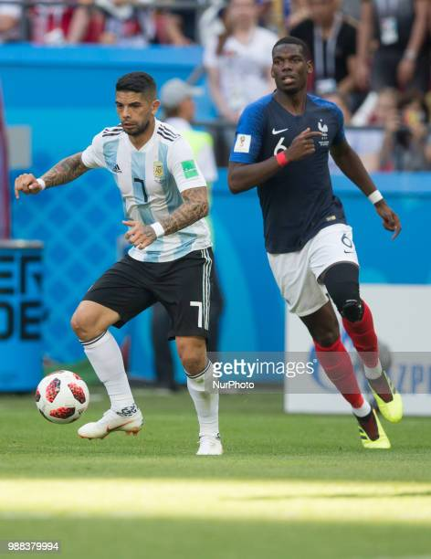 Ever Banega of Argentina vies Paul Pogba of France during the 2018 FIFA World Cup Russia Round of 16 match between France and Argentina at Kazan...