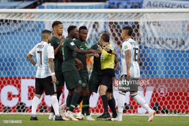 Ever Banega of Argentina William TroostEkong of Nigeria Wilfred Ndidi of Nigeria John Obi Mikel of Nigeria referee Cuneyt Cakir Marcos Rojo of...