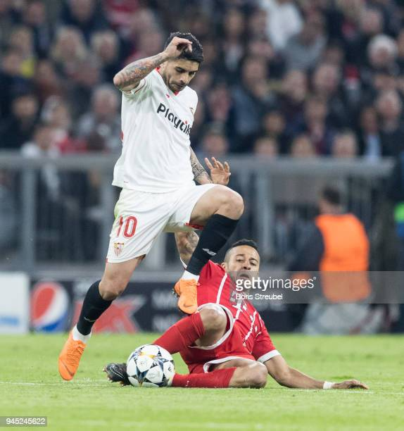 Ever Banega of FC Sevilla is tackled by Thiago Alcantara of FC Bayern Muenchen during the UEFA Champions League Quarter Final second leg match...