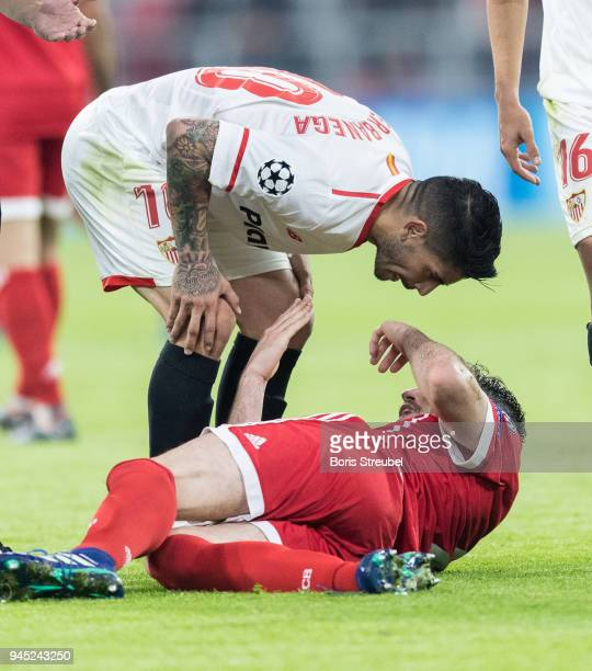 Ever Banega of FC Sevilla reacts with Javier Martinez of FC Bayern Muenchen during the UEFA Champions League Quarter Final second leg match between...
