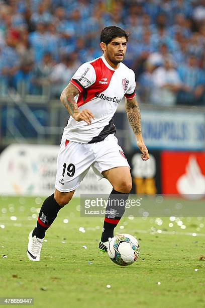 Ever Banega of Newell's Old Boys runs for the ball during the Copa Bridgestone Libertadores 2014 match between Gremio v Newell's Old Boys at Arena do...
