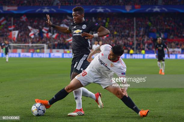 Ever Banega of Sevilla battles Paul Pgba of Manchester United during the UEFA Champions League Round of 16 First Leg match between Sevilla FC and...