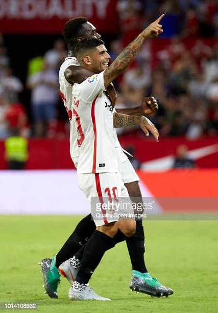 Ever Banega of Sevilla celebrates after scoring his sides first goal with his teammate Joris Gnagnon during the UEFA Europa League Third Qualifying...