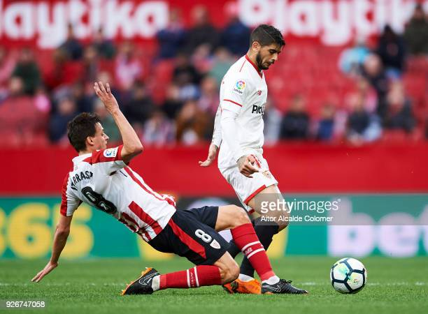 Ever Banega of Sevilla CF duels for the ball with Ander Iturraspe of Athletic Club during the La Liga match between Sevilla CF and Athletic Club at...