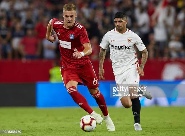 Ever Banega of Sevilla competes for the ball with Jakub Plsek of Sigma Olomuc during the UEFA Europa League Qualifying PlayOff Second Leg match...
